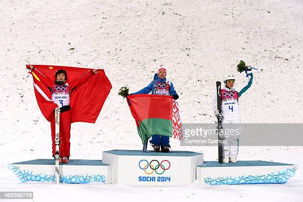 Silver medalist Xu Mengtao of China gold medalist Alla Tsuper of Belarus and bronze medalist Lydia Lassila of Australia celebrate on the podium...