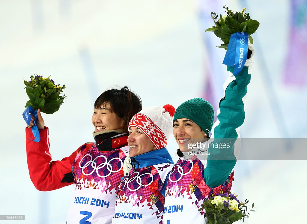 Silver medalist <a gi-track='captionPersonalityLinkClicked' href=/galleries/search?phrase=Xu+Mengtao&family=editorial&specificpeople=4131456 ng-click='$event.stopPropagation()'>Xu Mengtao</a> of China, gold medalist <a gi-track='captionPersonalityLinkClicked' href=/galleries/search?phrase=Alla+Tsuper&family=editorial&specificpeople=882784 ng-click='$event.stopPropagation()'>Alla Tsuper</a> of Belarus and bronze medalist <a gi-track='captionPersonalityLinkClicked' href=/galleries/search?phrase=Lydia+Lassila&family=editorial&specificpeople=4859096 ng-click='$event.stopPropagation()'>Lydia Lassila</a> of Australia celebrate on the podium during the flower ceremony for the Freestyle Skiing Ladies' Aerials Finals on day seven of the Sochi 2014 Winter Olympics at Rosa Khutor Extreme Park on February 14, 2014 in Sochi, Russia.