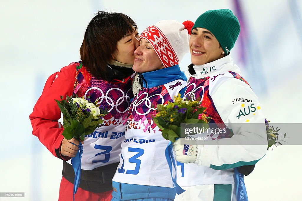 Silver medalist Xu Mengtao of China, gold medalist Alla Tsuper of Belarus and bronze medalist Lydia Lassila of Australia celebrate on the podium during the flower ceremony for the Freestyle Skiing Ladies' Aerials Finals on day seven of the Sochi 2014 Winter Olympics at Rosa Khutor Extreme Park on February 14, 2014 in Sochi, Russia.
