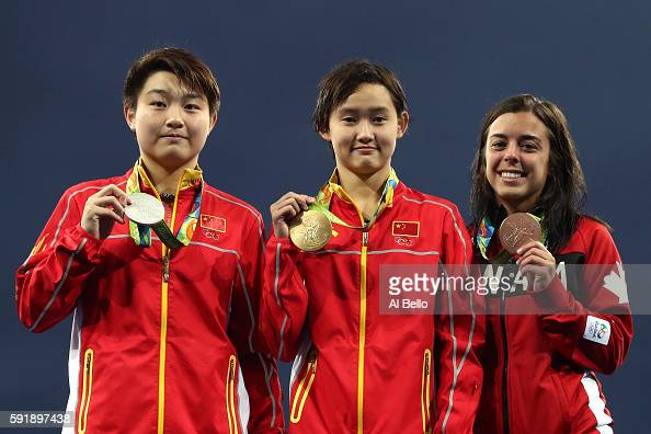 Silver medalist Yajie Si of China gold medalist Qian Ren of China and bronze medalist Meaghan Benfeito of Canada pose on the podium during the medal...