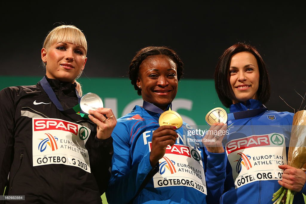 Silver medalist <a gi-track='captionPersonalityLinkClicked' href=/galleries/search?phrase=Yana+Maksimava&family=editorial&specificpeople=5436455 ng-click='$event.stopPropagation()'>Yana Maksimava</a> of Belarus, Gold medalist <a gi-track='captionPersonalityLinkClicked' href=/galleries/search?phrase=Ida+Antoinette+Nana+Djimou&family=editorial&specificpeople=6144069 ng-click='$event.stopPropagation()'>Ida Antoinette Nana Djimou</a> of France and bronze medalist <a gi-track='captionPersonalityLinkClicked' href=/galleries/search?phrase=Hanna+Melnychenko&family=editorial&specificpeople=1424232 ng-click='$event.stopPropagation()'>Hanna Melnychenko</a> of Ukraine during the victory ceremony for the Women's Pentathlon during day one of the European Athletics Indoor Championships at Scandinavium on March 1, 2013 in Gothenburg, Sweden.