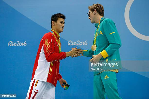 Silver medalist Yang Sun of China and gold medal medalist Mack Horton of Australia pose during the medal ceremony for the Final of the Men's 400m...