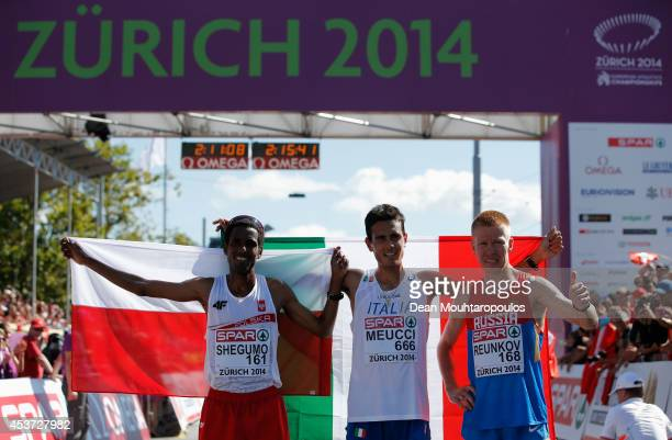 Silver medalist Yared Shegumo of Poland gold medalist Daniele Meucci of Italy bronze medalist Aleksey Reunkov of Russia celebrate after the Men's...