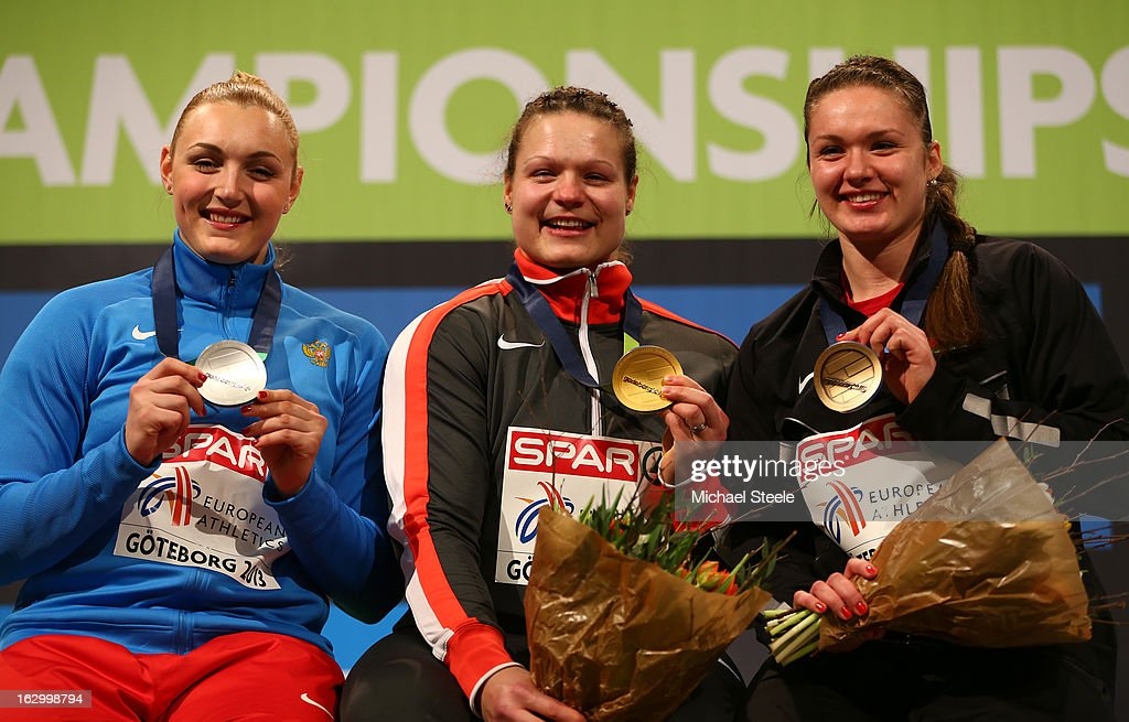 Silver medalist Yevgeniia Kolodko of Russia, Gold medalist Christina Schwanitz of Germany and Bronze medalist Alena Kopets of Belarus pose during the victory ceremony for the Women's Shot Put during day three of European Indoor Athletics at Scandinavium on March 3, 2013 in Gothenburg, Sweden.