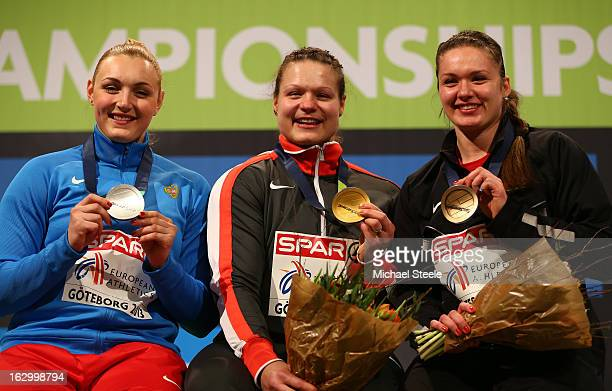Silver medalist Yevgeniia Kolodko of Russia Gold medalist Christina Schwanitz of Germany and Bronze medalist Alena Kopets of Belarus pose during the...