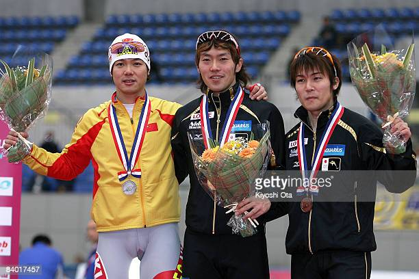 Silver medalist Yu Fengtong of China gold medalist Keiichiro Nagashima of Japan and bronze medalist Joji Kato of Japan pose during medal ceremony...