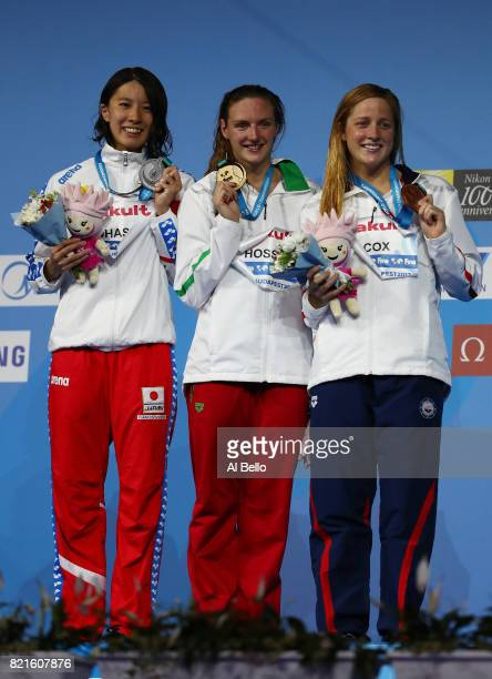 Silver medalist Yui Ohashi of Japan gold medalist Katinka Hosszu of Hungary and bronze medalist Madisyn Cox of the United States celebrate their...