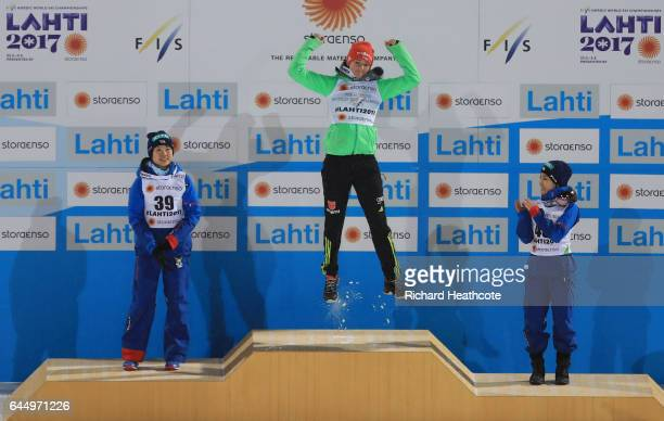 Silver medalist Yuki Ito of Japan gold medalist Carina Vogt of Germany and bronze medaliist Sara Takanashi of Japan celebrate following the Women's...