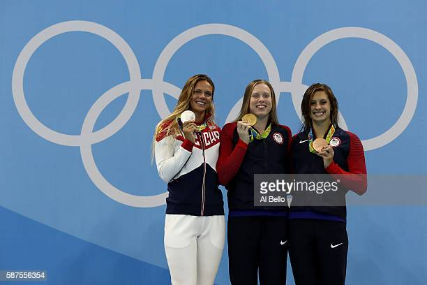 Silver medalist Yulia Efimova of Russia gold medal medallist Lilly King of the United States and bronze medallist Katie Meili of the United States...