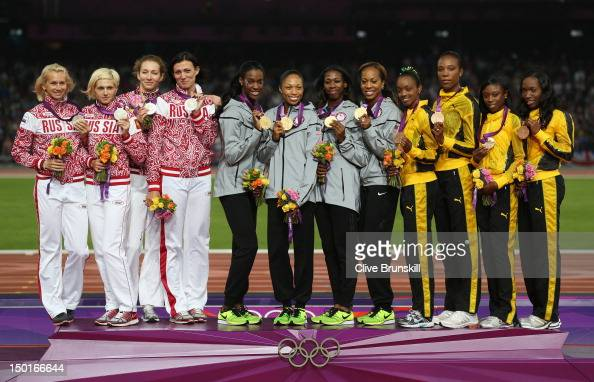 Silver medalist Yulia Gushchina Antonina Krivoshapka Tatyana Firova Natalya Antyukh of Russia gold medalist DeeDee Trotter Allyson Felix Francena...
