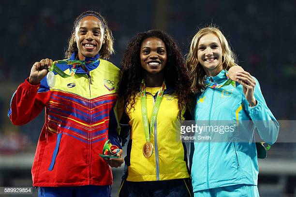 Silver medalist Yulimar Rojas of Venezuela gold medalist Caterine Ibarguen of Colombia and bronze medalist Olga Rypakova of Kazakhstan pose on the...