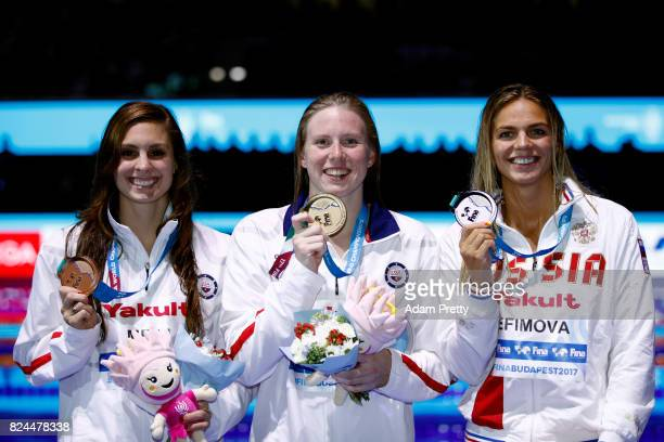 Silver medalist Yuliya Efimova of Russia gold medalist Lilly King of the United States and bronze medalist Katie Meili of the United States pose with...