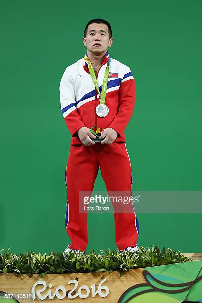 Silver medalist Yun Chol Om of North Korea celebrates on the podium after the Men's 56kg Group A weightlifting contest on Day 2 of the Rio 2016...