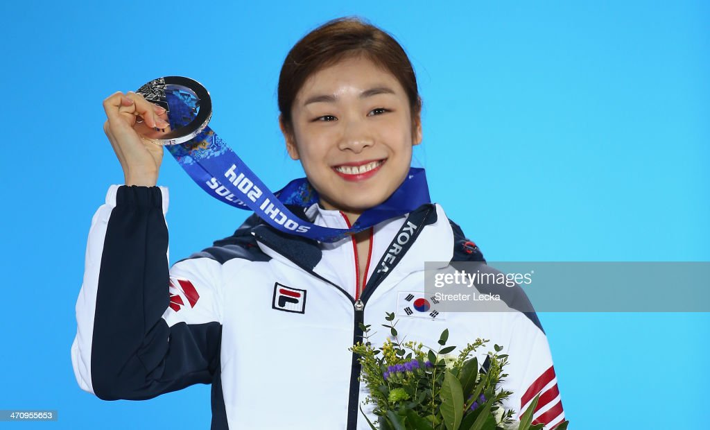 Silver medalist Yuna Kim of South Korea celebrates during the medal for the Women's Free Figure Skating on day fourteen of the Sochi 2014 Winter Olympics at Medals Plaza on February 21, 2014 in Sochi, Russia.