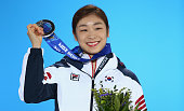 Silver medalist Yuna Kim of South Korea celebrates during the medal for the Women's Free Figure Skating on day fourteen of the Sochi 2014 Winter...