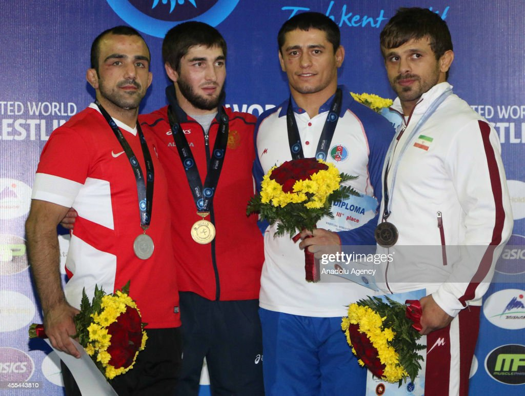 Silver medalist Yunus Ozel mens GrecoRoman Style 71 kg division pose during the medal ceremony for the men's freestyle wrestling at the Wrestling...