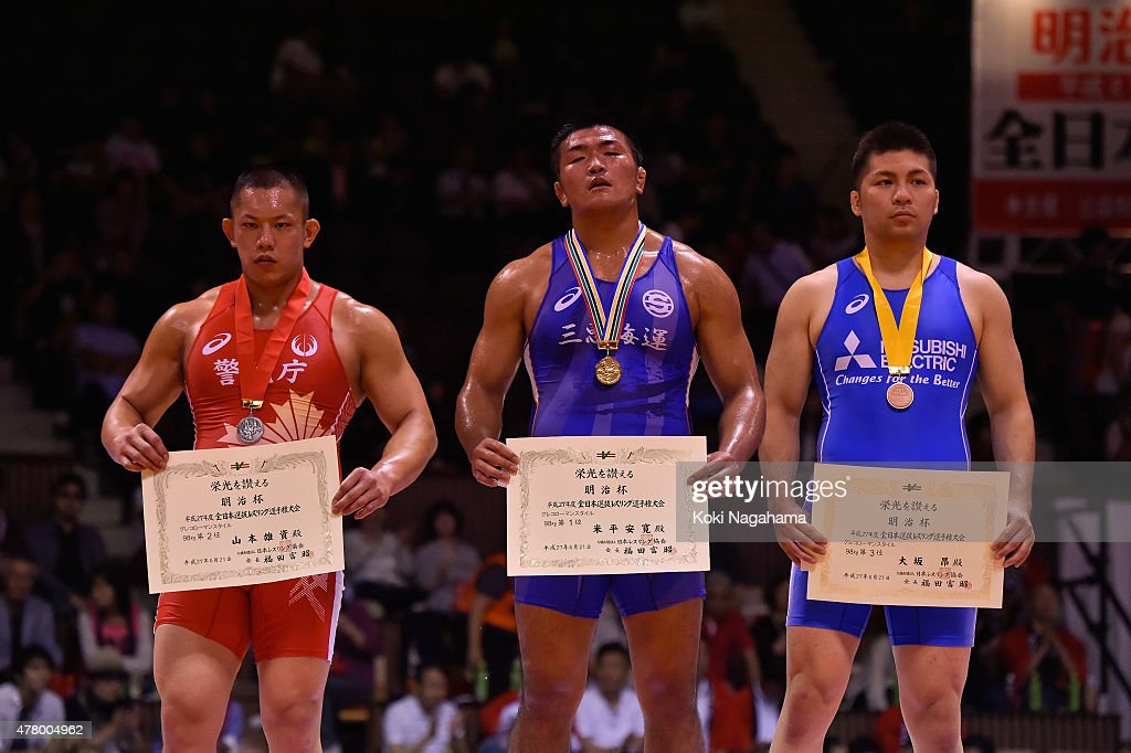 Silver medalist Yusuke Yamamoto and Gold medalist Yasuhiro Yonehira and Bronz medalist Akira Osaka pose for photographs on the podium at the award ceremony of the Men's 98kg greco-roman style during All Japan Wrestling Championships at Yoyogi National Gymnasium on June 21, 2015 in Tokyo, Japan.