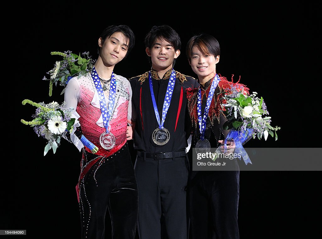Silver medalist Yuzuru Hanyu, gold medalist <a gi-track='captionPersonalityLinkClicked' href=/galleries/search?phrase=Takahiko+Kozuka&family=editorial&specificpeople=686867 ng-click='$event.stopPropagation()'>Takahiko Kozuka</a>, and bronze medalist Tatsuki Machida of Japan pose for photos after the men's free skate during the Skate America competition at the ShoWare Center on October 20, 2012 in Kent, Washington.