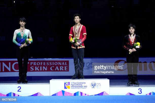 Silver medalist Yuzuru Hanyu of Japan and Gold medalist Nathan Chen of United States and Bronze medalist Shoma Uno pose on the podium during the...