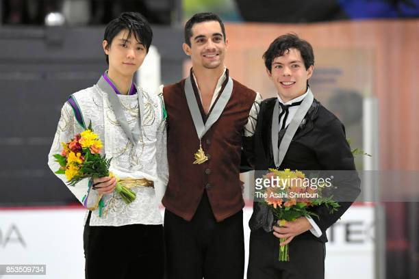 Silver medalist Yuzuru Hanyu of Japan gold medalist Javier Fernandez of Spain and bronze medalist Keegan Messing of Canada pose on the podium at the...