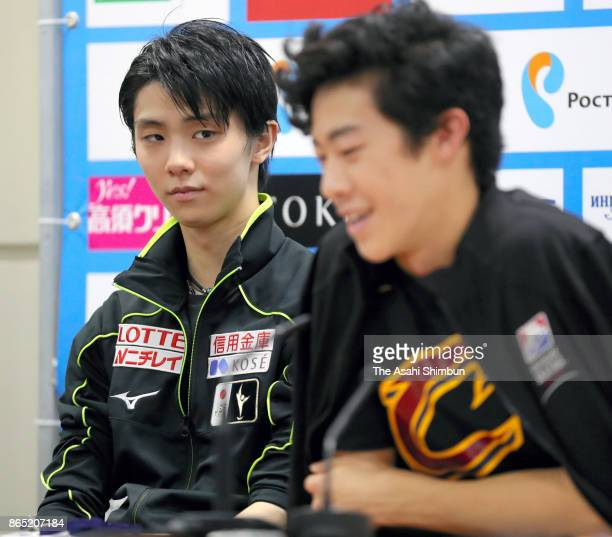 Silver medalist Yuzuru Hanyu of Japan watches gold medalist Nathan Chen of United States during a press conference after the Men's Singles Free...
