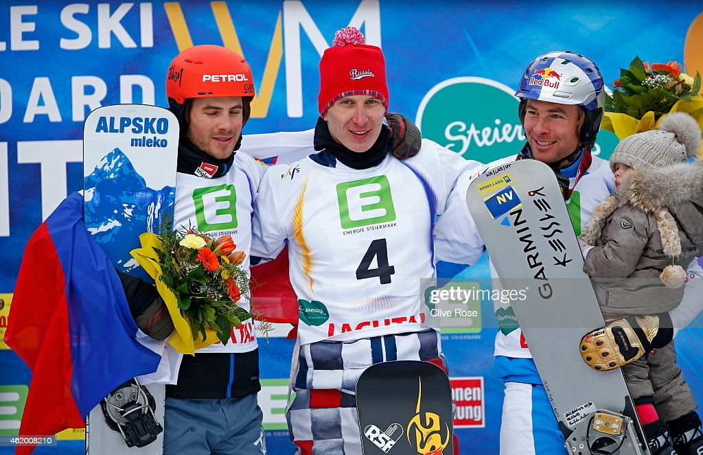 Silver medalist Zan Kosir of Slovenia, gold medalist <a gi-track='captionPersonalityLinkClicked' href=/galleries/search?phrase=Andrey+Sobolev&family=editorial&specificpeople=12488011 ng-click='$event.stopPropagation()'>Andrey Sobolev</a> of Russia and bronze medalist <a gi-track='captionPersonalityLinkClicked' href=/galleries/search?phrase=Benjamin+Karl&family=editorial&specificpeople=4586461 ng-click='$event.stopPropagation()'>Benjamin Karl</a> of Austria celebrate following the Men's Parallel Giant Slalom Finals during the FIS Freestyle Ski and Snowboard World Championships 2015 on January 23, 2015 in Lachtal, Austria.