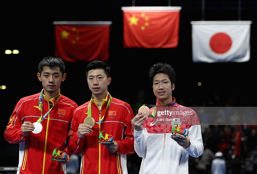 Silver medalist Zhang Jike of China, gold medalist Ma Long of China and bronze medalist Jun Mizutani of Japan pose on the podium during the medal ceremony for the Mens Table Tennis at Rio Centro on August 11, 2016 in Rio de Janeiro, Brazil.