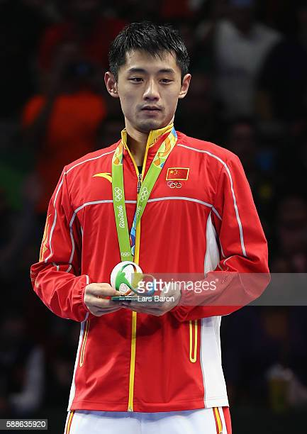 Silver medalist Zhang Jike of China poses on the podium during the medal ceremony for the Mens Table Tennis Gold Medal match between Ma Long of China...