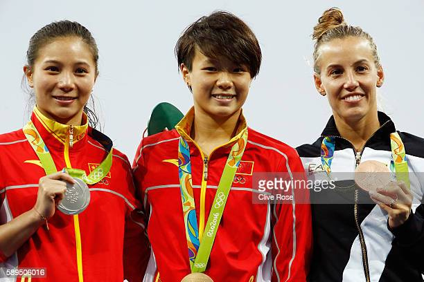 Silver medalist Zi He of China gold medalist Tingmao Shi of China and bronze medalist Tania Cagnotto of Italy pose on the podium during the medal...