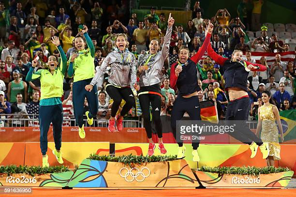 Silver medalists Agatha Bednarczuk Rippel and Barbara Seixas de Freitas of Brazil gold medalists Laura Ludwig and Kira Walkenhorst of Germany and...