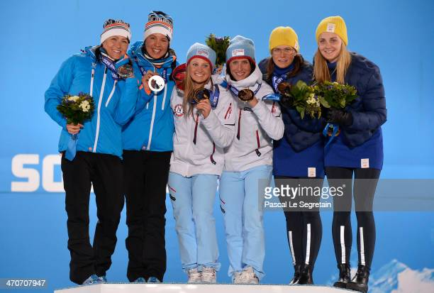 Silver medalists AinoKaisa Saarinen and Kerttu Niskanen of Finland gold medalists Ingvild Flugstad Oestberg and Marit Bjoergen of Norway and bronze...