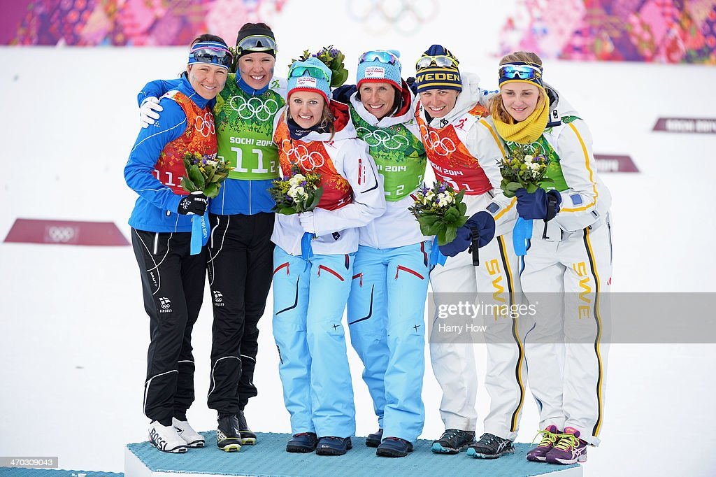 Silver medalists <a gi-track='captionPersonalityLinkClicked' href=/galleries/search?phrase=Aino-Kaisa+Saarinen&family=editorial&specificpeople=769322 ng-click='$event.stopPropagation()'>Aino-Kaisa Saarinen</a> of Finland and <a gi-track='captionPersonalityLinkClicked' href=/galleries/search?phrase=Kerttu+Niskanen&family=editorial&specificpeople=7526325 ng-click='$event.stopPropagation()'>Kerttu Niskanen</a> of FinlFinland, gold medalists <a gi-track='captionPersonalityLinkClicked' href=/galleries/search?phrase=Ingvild+Flugstad+Oestberg&family=editorial&specificpeople=7427144 ng-click='$event.stopPropagation()'>Ingvild Flugstad Oestberg</a> of Norway and <a gi-track='captionPersonalityLinkClicked' href=/galleries/search?phrase=Marit+Bjoergen&family=editorial&specificpeople=216406 ng-click='$event.stopPropagation()'>Marit Bjoergen</a> of Norway and bronze medalists <a gi-track='captionPersonalityLinkClicked' href=/galleries/search?phrase=Ida+Ingemarsdotter&family=editorial&specificpeople=5640296 ng-click='$event.stopPropagation()'>Ida Ingemarsdotter</a> of Sweden and <a gi-track='captionPersonalityLinkClicked' href=/galleries/search?phrase=Stina+Nilsson&family=editorial&specificpeople=10116472 ng-click='$event.stopPropagation()'>Stina Nilsson</a> of Sweden celebrate on the podium during the flower ceremony for the Women's Team Sprint Classic Final during day 12 of the 2014 Sochi Winter Olympics at Laura Cross-country Ski & Biathlon Center on February 19, 2014 in Sochi, Russia.