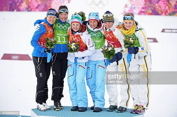 Silver medalists AinoKaisa Saarinen of Finland and Kerttu Niskanen of FinlFinland gold medalists Ingvild Flugstad Oestberg of Norway and Marit...