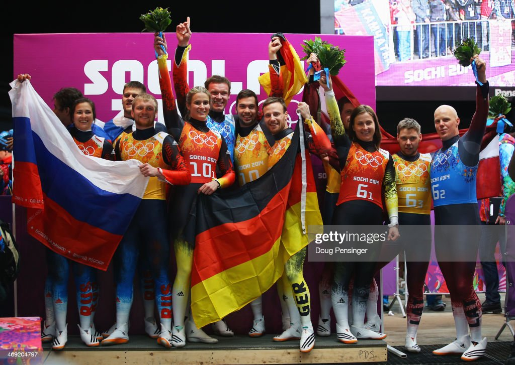 Silver medalists Albert Demchenko, Tatyana Ivanova, <a gi-track='captionPersonalityLinkClicked' href=/galleries/search?phrase=Alexander+Denisyev&family=editorial&specificpeople=12466169 ng-click='$event.stopPropagation()'>Alexander Denisyev</a> and <a gi-track='captionPersonalityLinkClicked' href=/galleries/search?phrase=Vladislav+Antonov&family=editorial&specificpeople=8891668 ng-click='$event.stopPropagation()'>Vladislav Antonov</a> of Russia, gold medalists <a gi-track='captionPersonalityLinkClicked' href=/galleries/search?phrase=Natalie+Geisenberger&family=editorial&specificpeople=4698568 ng-click='$event.stopPropagation()'>Natalie Geisenberger</a>, <a gi-track='captionPersonalityLinkClicked' href=/galleries/search?phrase=Felix+Loch&family=editorial&specificpeople=4840944 ng-click='$event.stopPropagation()'>Felix Loch</a>, <a gi-track='captionPersonalityLinkClicked' href=/galleries/search?phrase=Tobias+Wendl&family=editorial&specificpeople=4784289 ng-click='$event.stopPropagation()'>Tobias Wendl</a> and <a gi-track='captionPersonalityLinkClicked' href=/galleries/search?phrase=Tobias+Arlt&family=editorial&specificpeople=4784288 ng-click='$event.stopPropagation()'>Tobias Arlt</a> of Germany and bronze medalists <a gi-track='captionPersonalityLinkClicked' href=/galleries/search?phrase=Andris+Sics&family=editorial&specificpeople=815025 ng-click='$event.stopPropagation()'>Andris Sics</a>, Eliza Tiruma, <a gi-track='captionPersonalityLinkClicked' href=/galleries/search?phrase=Juris+Sics&family=editorial&specificpeople=815301 ng-click='$event.stopPropagation()'>Juris Sics</a> and Martins Ruebenis of Latvia celebrate on the podium during the flower ceremony for the Luge Relay on Day 6 of the Sochi 2014 Winter Olympics at Sliding Center Sanki on February 13, 2014 in Sochi, Russia.