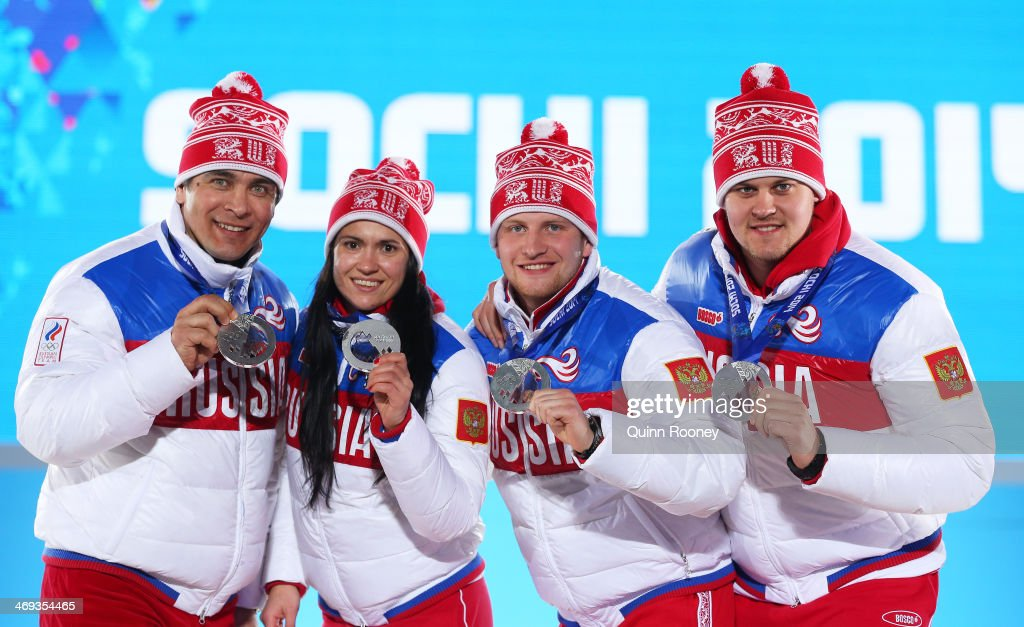 Silver medalists Albert Demchenko, Tatyana Ivanova, <a gi-track='captionPersonalityLinkClicked' href=/galleries/search?phrase=Vladislav+Antonov&family=editorial&specificpeople=8891668 ng-click='$event.stopPropagation()'>Vladislav Antonov</a> and <a gi-track='captionPersonalityLinkClicked' href=/galleries/search?phrase=Alexander+Denisyev&family=editorial&specificpeople=12466169 ng-click='$event.stopPropagation()'>Alexander Denisyev</a> of Russia celebrate on the podium during the medal for the Luge Team Relay on day 7 of the Sochi 2014 Winter Olympics at Medals Plaza on February 14, 2014 in Sochi, Russia.