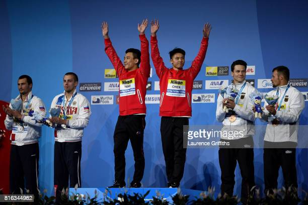 Silver medalists Aleksandr Bondar and Viktor Minibaev of Russia gold medalists Aisen Chen and Hao Yang of China and bronze medalists Patrick Hausding...