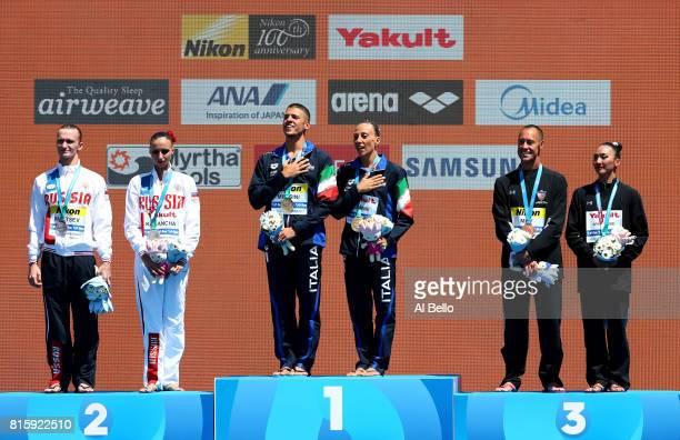 Silver medalists Aleksandr Maltsev and Mikhaela Kalancha of Russia gold medalists Giorgio Minisini and Manila Flamini of Italy and bronze medalists...