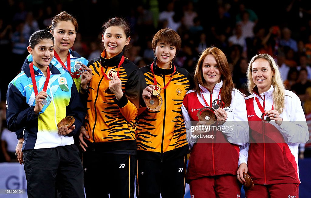 Silver medalists Ashwini Ponnappa and <a gi-track='captionPersonalityLinkClicked' href=/galleries/search?phrase=Jwala+Gutta&family=editorial&specificpeople=795812 ng-click='$event.stopPropagation()'>Jwala Gutta</a> of India, gold medalists Khe Wei Woon and Vivian Kah Mun Hoo of Malaysia and bronze medalists Lauren Smith and <a gi-track='captionPersonalityLinkClicked' href=/galleries/search?phrase=Gabrielle+Adcock&family=editorial&specificpeople=12344224 ng-click='$event.stopPropagation()'>Gabrielle Adcock</a> of England pose in the medal ceremony for the Women's Doubles Gold Medal Match at Emirates Arena during day eleven of the Glasgow 2014 Commonwealth Games on August 3, 2014 in Glasgow, United Kingdom.