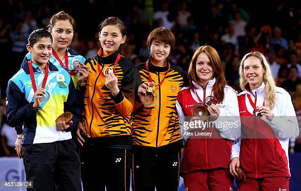 Silver medalists Ashwini Ponnappa and Jwala Gutta of India gold medalists Khe Wei Woon and Vivian Kah Mun Hoo of Malaysia and bronze medalists Lauren...