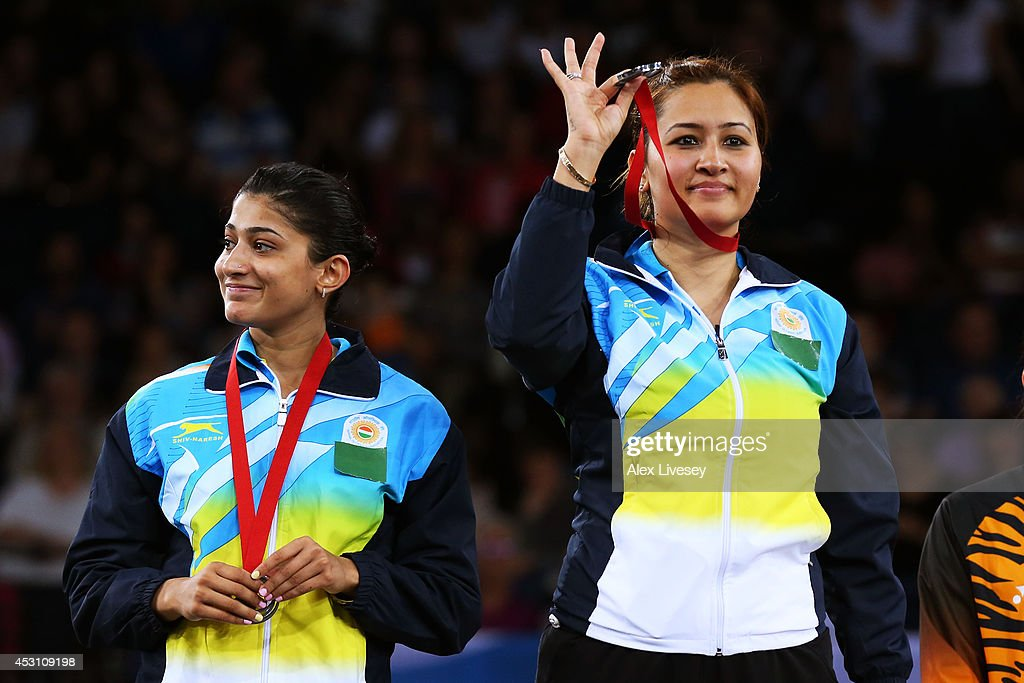 Silver medalists Ashwini Ponnappa and <a gi-track='captionPersonalityLinkClicked' href=/galleries/search?phrase=Jwala+Gutta&family=editorial&specificpeople=795812 ng-click='$event.stopPropagation()'>Jwala Gutta</a> of India pose in the medal ceremony for the Women's Doubles Gold Medal Match at Emirates Arena during day eleven of the Glasgow 2014 Commonwealth Games on August 3, 2014 in Glasgow, United Kingdom.