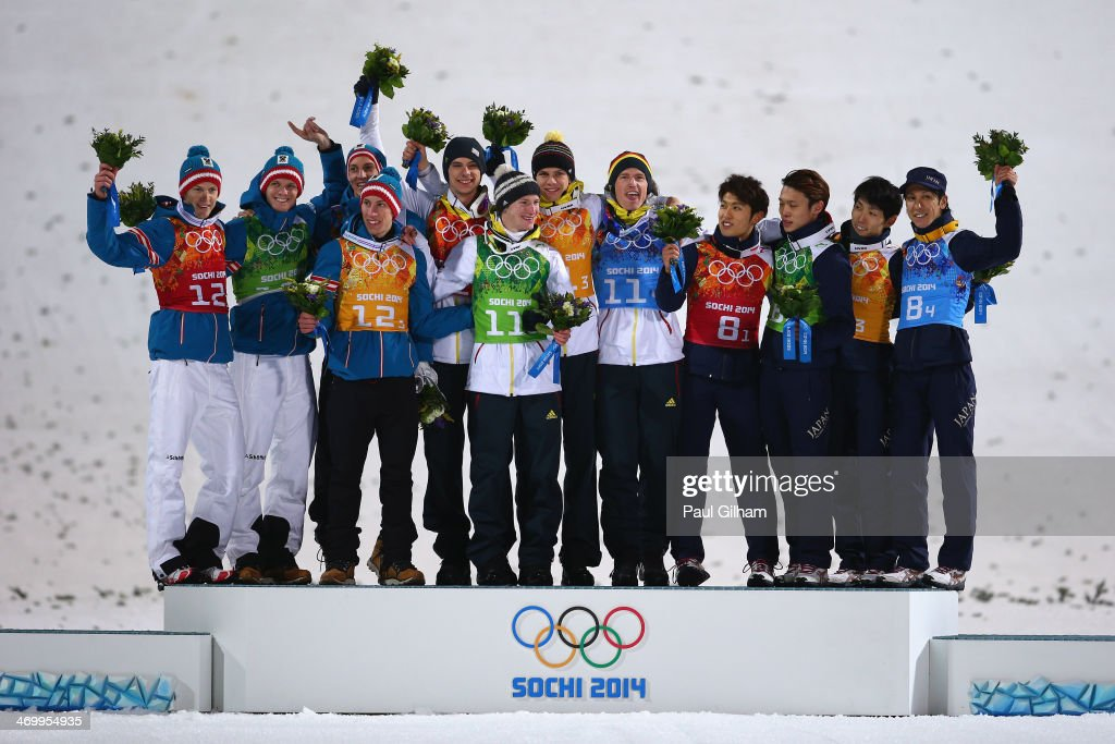 Silver medalists Austria, gold medalists Germany and bronze medalists Japan celebrate during the flower ceremony for the Men's Team Ski Jumping final round on day 10 of the Sochi 2014 Winter Olympics at the RusSki Gorki Ski Jumping Center on February 17, 2014 in Sochi, Russia.
