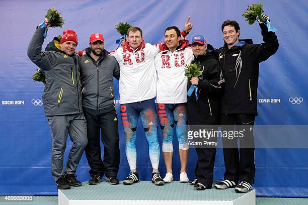 Silver medalists Beat Hefti and Alex Baumann of Switzerland team 1 gold medalists Alexander Zubkov and Alexey Voevoda of Russia team 1 and bronze...