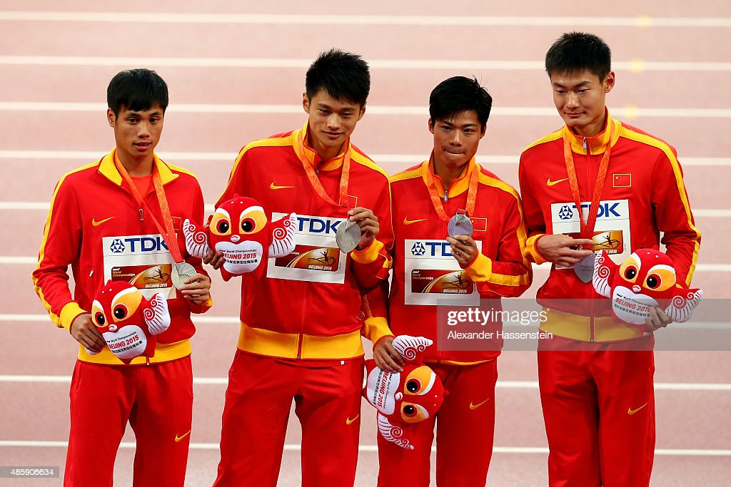 Silver medalists Bingtian Su of China, Zhenye Xie of China, Peimeng Zhang of China and Youxue Mo of China pose on the podium during the medal ceremony for the Men's 4x100 Metres Relay final during day nine of the 15th IAAF World Athletics Championships Beijing 2015 at Beijing National Stadium on August 30, 2015 in Beijing, China.