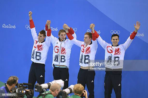 Silver medalists Daniel Wallace James Guy Stephen Milne and Duncan Scott of Great Britain pose on the podium during the medal presentation for the...