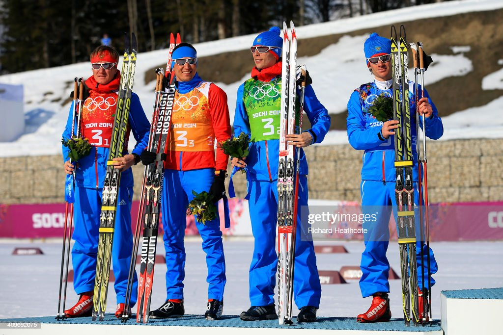 Silver medalists Dmitriy Japarov, Alexander Bessmertnykh, <a gi-track='captionPersonalityLinkClicked' href=/galleries/search?phrase=Alexander+Legkov&family=editorial&specificpeople=4037875 ng-click='$event.stopPropagation()'>Alexander Legkov</a> and <a gi-track='captionPersonalityLinkClicked' href=/galleries/search?phrase=Maxim+Vylegzhanin&family=editorial&specificpeople=4779618 ng-click='$event.stopPropagation()'>Maxim Vylegzhanin</a> of Russia celebrate on the podium during the flower ceremony for the Cross Country Men's 4 x 10 km Relay during day nine of the Sochi 2014 Winter Olympics at Laura Cross-country Ski & Biathlon Center on February 16, 2014 in Sochi, Russia.