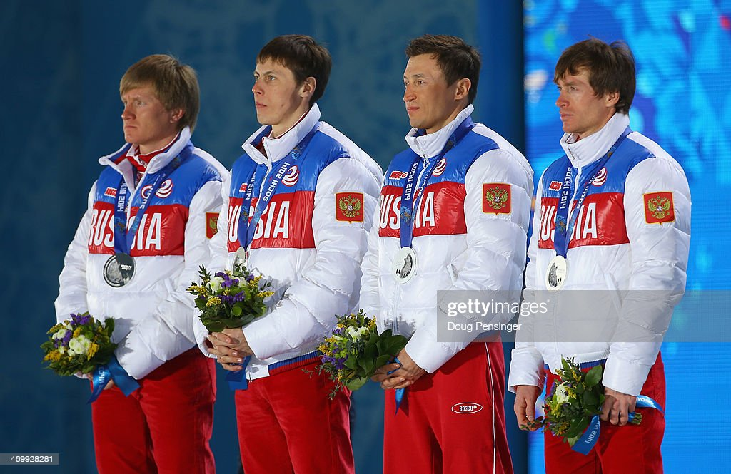 Silver medalists Dmitriy Japarov, Alexander Bessmertnykh, <a gi-track='captionPersonalityLinkClicked' href=/galleries/search?phrase=Alexander+Legkov&family=editorial&specificpeople=4037875 ng-click='$event.stopPropagation()'>Alexander Legkov</a> and <a gi-track='captionPersonalityLinkClicked' href=/galleries/search?phrase=Maxim+Vylegzhanin&family=editorial&specificpeople=4779618 ng-click='$event.stopPropagation()'>Maxim Vylegzhanin</a> of Russia celebrate on the podium during the medal ceremony for the Cross Country Men's 4 x 10 km Relay on day ten of the Sochi 2014 Winter Olympics at the Medals Plaza on February 17, 2014 in Sochi, Russia.