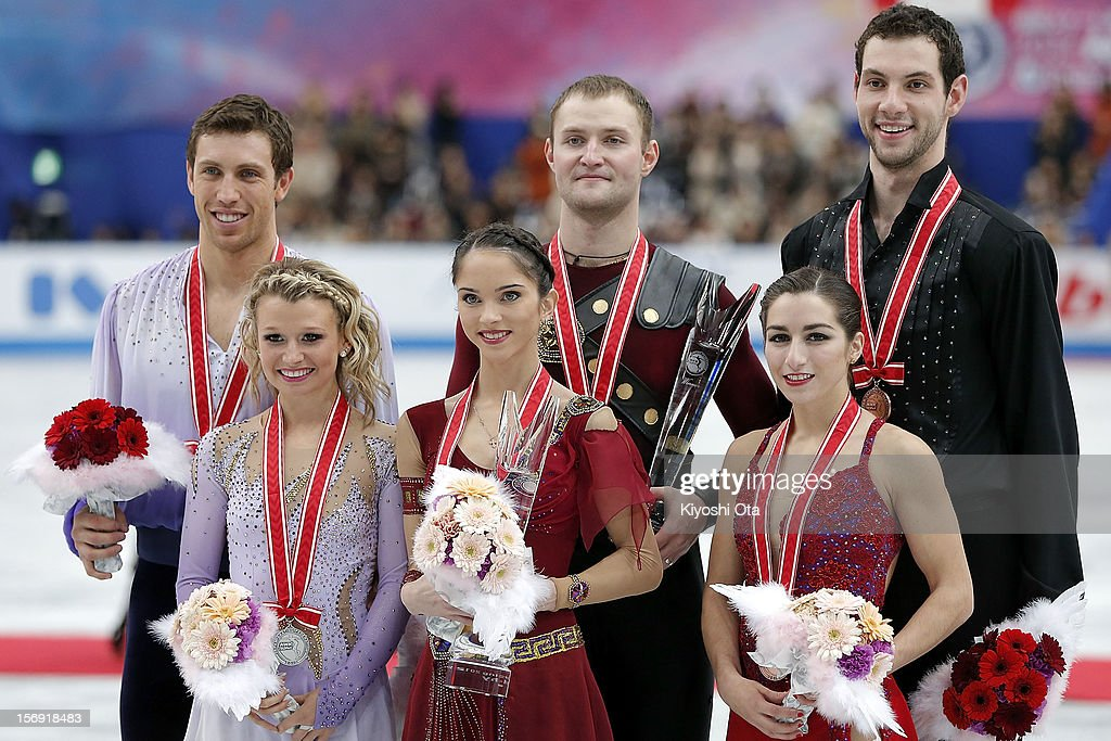 Silver medalists Dylan Moscovitch and Kristen Moore-Towers of Canada, gold medalists Vera Bazarova and Yuri Larionov of Russia and bronze medalists Marissa Castelli and Simon Shnapir of the United States pose for photographs at the medal ceremony after the Pairs competition during day three of the ISU Grand Prix of Figure Skating NHK Trophy at Sekisui Heim Super Arena on November 25, 2012 in Rifu, Japan.