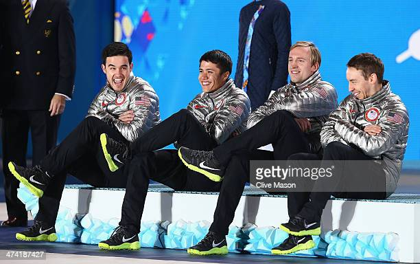 Silver medalists Eduardo Alvarez JR Celski Christopher Creveling and Jordan Malone of the United States celebrate on the podium during the medal...