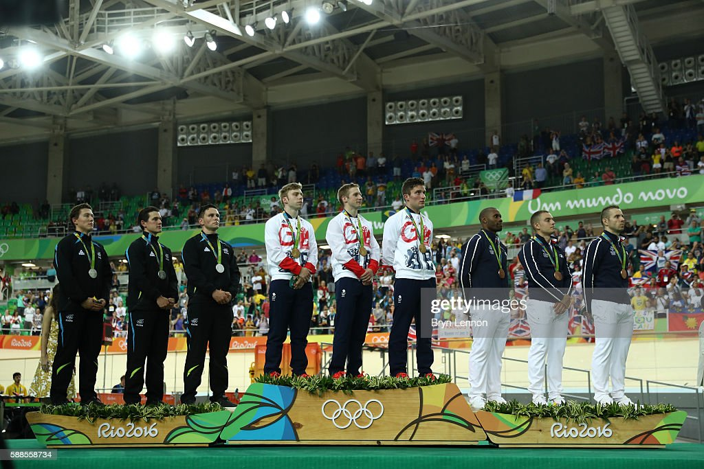 Silver medalists Edward Dawkins, Sam Webster and Ethan Mitchell of New Zealand, gold medalists Philip Hindes, Jason Kenny and Callum Skinner of Great Britain and bronze medalists Gregory Bauge, Michael D'Almeida and Francois Pervis of France stand on the podium after the Men's Team Sprint Track Cycling Finals on Day 6 of the 2016 Rio Olympics at Rio Olympic Velodrome on August 11, 2016 in Rio de Janeiro, Brazil.