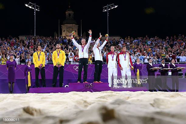 Silver medalists Emanuel Rego and Alison Cerutti of Brazil Gold medalists Jonas Reckermann and Julius Brink of Germany and bronze medalists Janis...